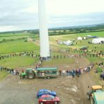 High level view of people and vehicles in a loop around a turbine